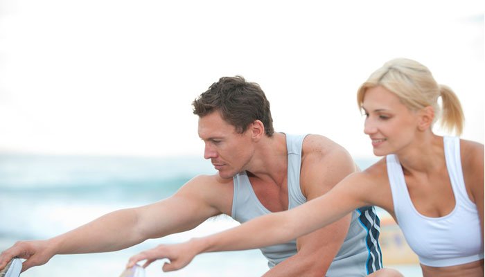 Kelowna Gyms - One Life Fitness - couple stretching
