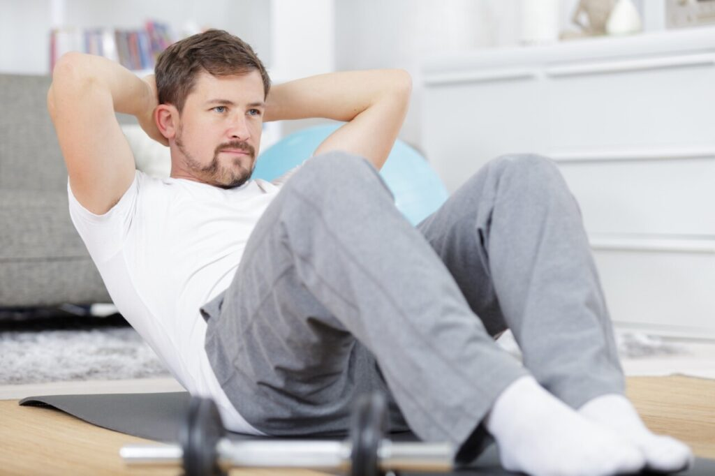 Man doing crunches in at-home workout